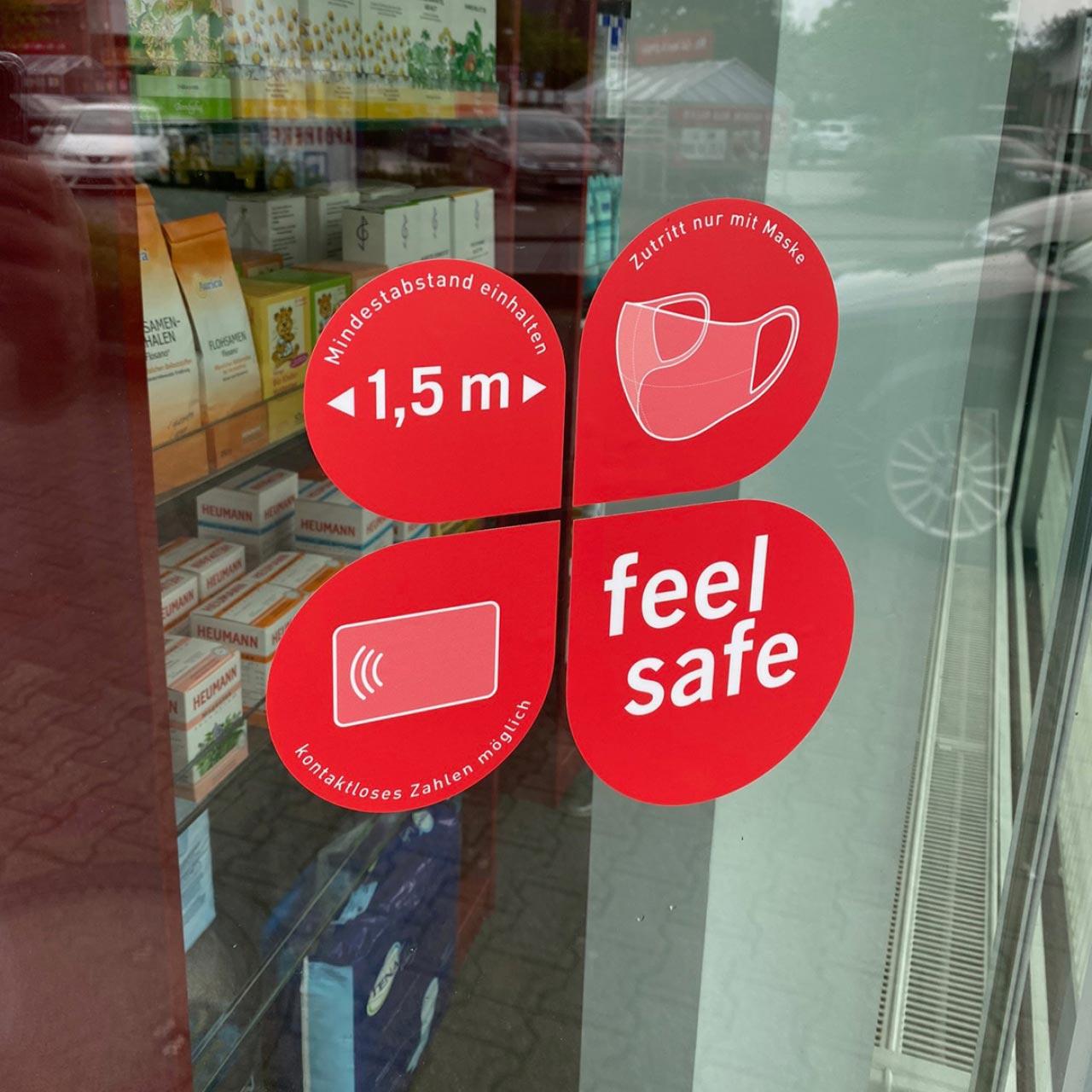 Vierteiliger Schaufensteraufkleber 38x38,5cm, magenta– Verhaltensregeln »feel safe«