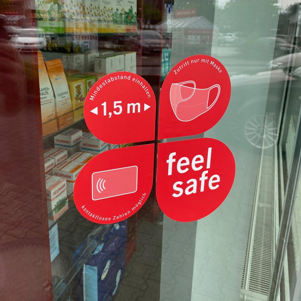 Vierteiliger Schaufensteraufkleber 25x25,4cm, rot – Verhaltensregeln »feel safe«