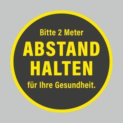 Fußbodenaufkleber, gelb-schwarz, rund 48cm – 2 Meter Abstand halten